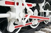 image of train-wheel  - Wheel of train with white and red mechanism on railway - JPG