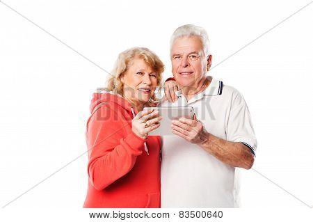Senior couple using tablet. Isolated on white background.