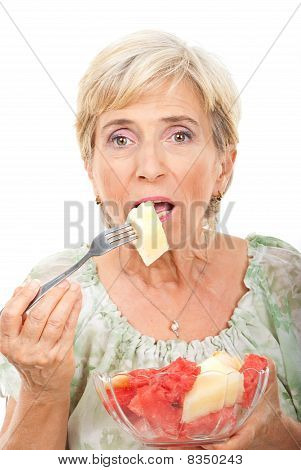 Senior Woman  Eating Melons Salad