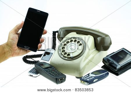 New smart phone with old telephone on white background. New communication technology.
