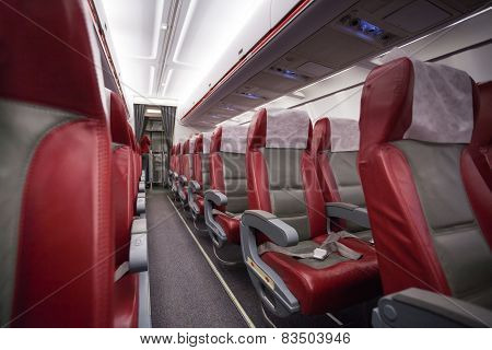 Long aisle with rows of sits in airlane