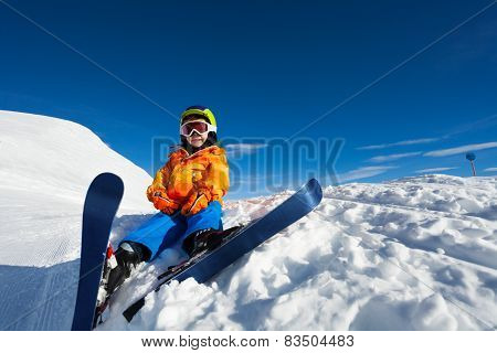 Smiling boy wearing ski mask and helmet on snow