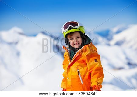 Portrait of smiling boy with ski mask and helmet