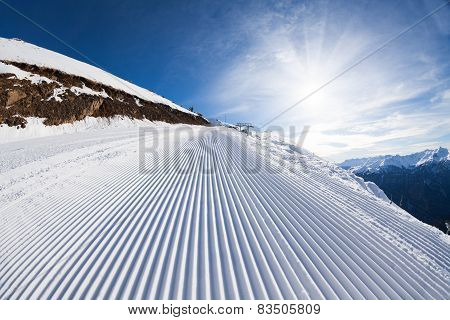 Sunny winter landscape of snow ski-track in Sochi