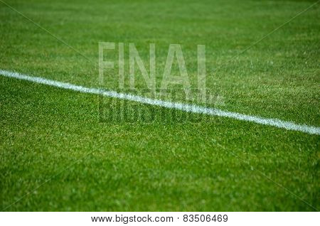 Football final text on grass with white lane