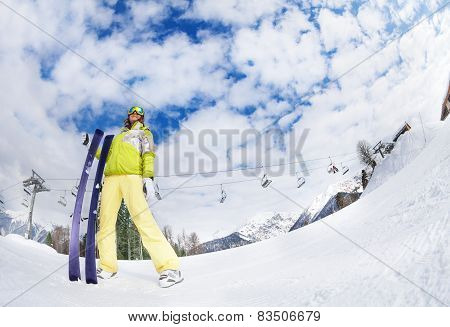 Young woman in mask holding ski fisheye view