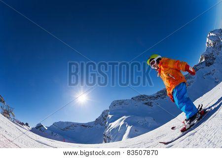 Fisheye view of boy on beautiful mountain slope