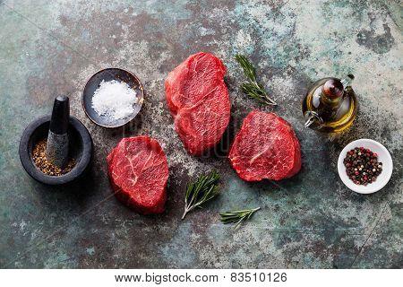 Raw Fresh Marbled Meat Steak And Seasonings On Metal Background