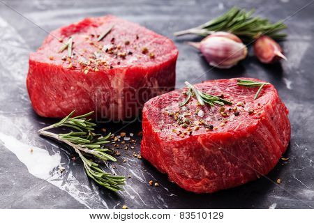 Raw Fresh Marbled Meat Steak And Seasonings On Dark Marble Background Close-up