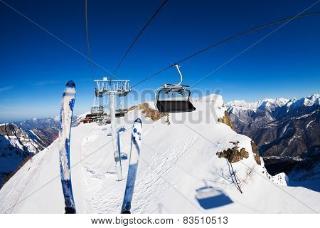 Ski and skilift ropeway with chairs over mountains