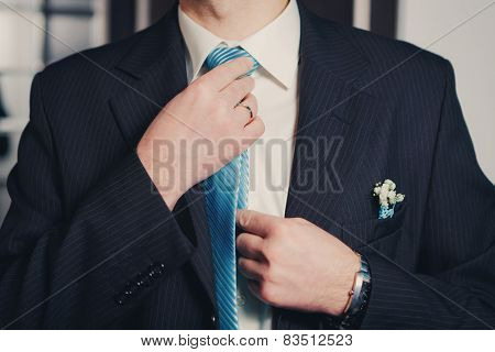Man's Hands Closeup Tying His Tie Knot
