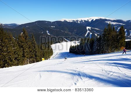 BUKOVEL, UKRAINE - FEBRUARY 17: The skiers are on a slope in Bukovel. It is the largest ski resort i