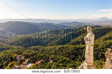 Sculpture Apostle And Mountains Near Barcelona