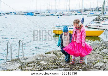 Outdoor portrait of cute children having fun