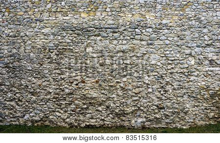 Ancient Stone Wall Of The Castle. Texture Of Rough Stone