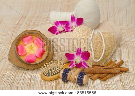 Spa Massage Setting With Rolled, Towel, Compress Balls And Aroma Candle