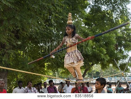 Small Girl Dances On Rope.