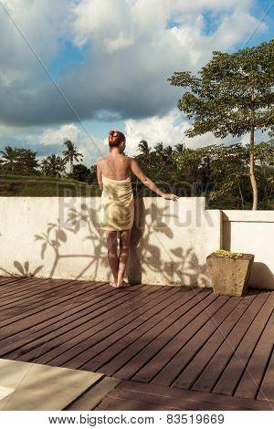 Young woman wearing towel