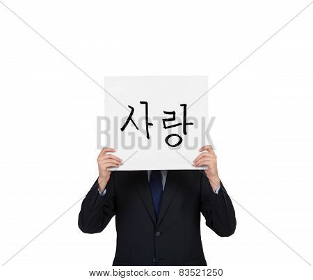businessman holding poster