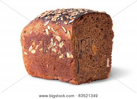 Half Unleavened Of Black Bread With Seeds And Dried Fruit