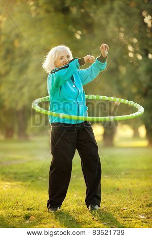 Senior Woman Doing Exercises In Nature