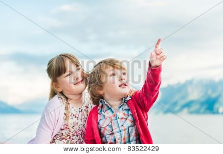 Outdoor portrait of a toddler brother and his sister