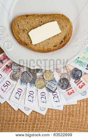 British Money, Piece Of Bread On Plate. Food Budget.