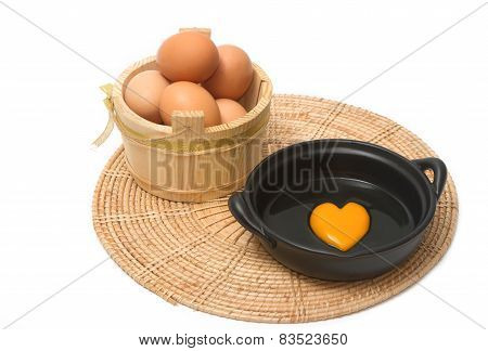 A Heart-shaped Egg Yolk In The Black Bowl With Eggs