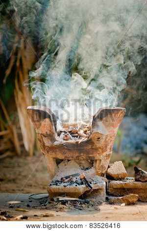 Clay Stove With Burning Wood
