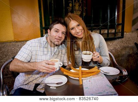 Young Beautiful American Tourist Couple Having Spanish Typical Breakfast Hot Chocolate With Churros