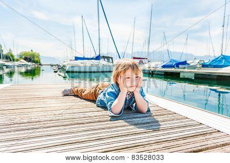Little blond boy outdoors