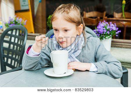 Little girl in cafe