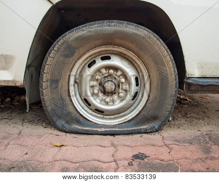 Deflated Damaged Tyre On Car Wheel
