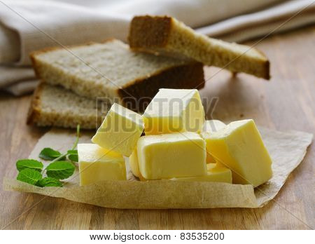 fresh yellow butter served on a wooden board