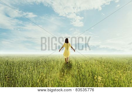 Young Woman Walking On Summer Meadow