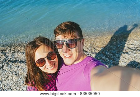 Loving Couple Doing Self-portrait On Beach