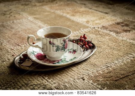 Closeup Of Tea Cup On White Carpet