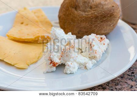 Ricotta And Yellow Cheeses