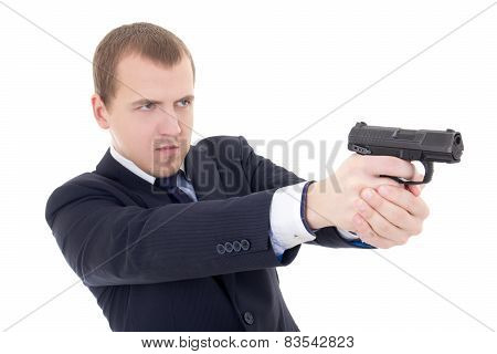 Young Man In Business Suit Shooting With Gun Isolated On White