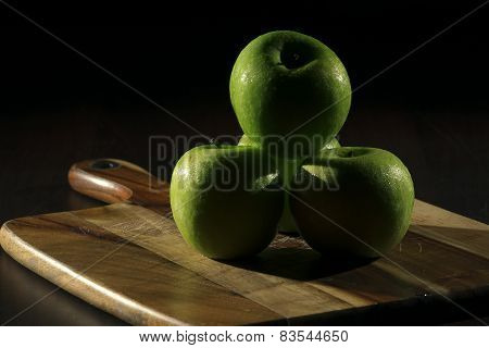 Green apples with low key lighting.