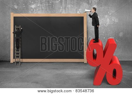 Sales Man Using Megaphone On Red Percentage Sign With Blackboard