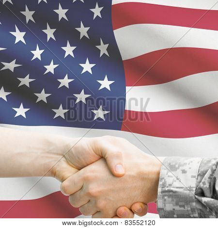 Soldier And Doctor Shaking Hands. Flag On Background - United States