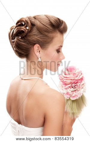 Beautiful Bride With Bouquet Looking Down At The White Background