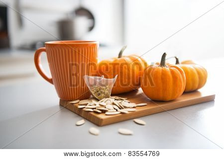 Closeup On Small Pumpkins Seeds And Tea Bag On Table