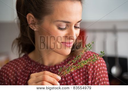 Portrait Of Young Housewife Enjoying Fresh Thymus