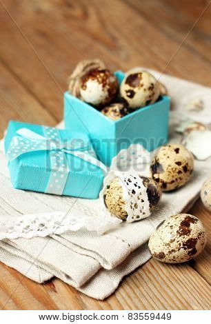 Quail Eggs In A Gift Box Lying On A Wooden Table