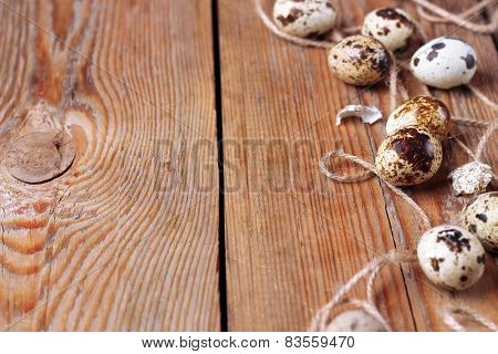Quail Eggs And A Rope Lying On A Wooden Table