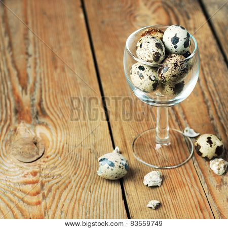 Quail Eggs In A Glass On A Wooden Table