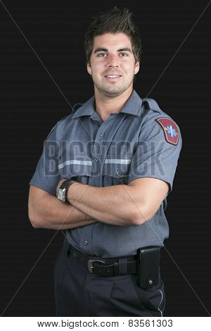 Paramedic employee in the front of a black background