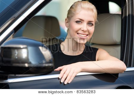 Young woman sitting inside car